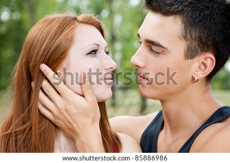 close up of young romantic couple, outdoor