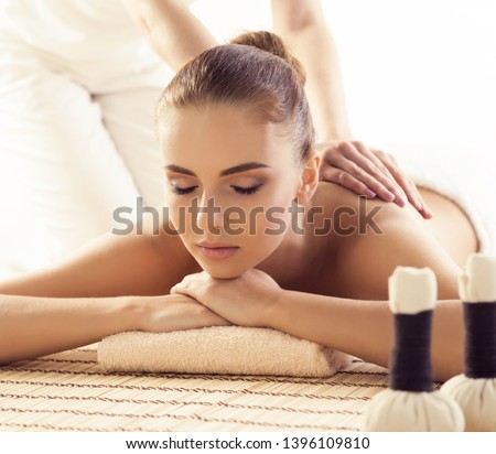 Close-up of young woman in spa. Traditional healing therapy and massaging treatments.