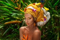 close up of young woman in turban with flowers