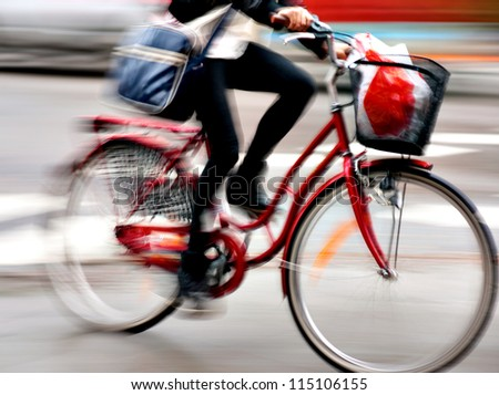 Close up of young woman on bike in blurred motion