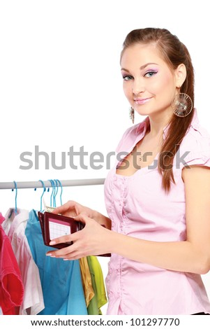 Close-up of young woman paying for her purchases isolated