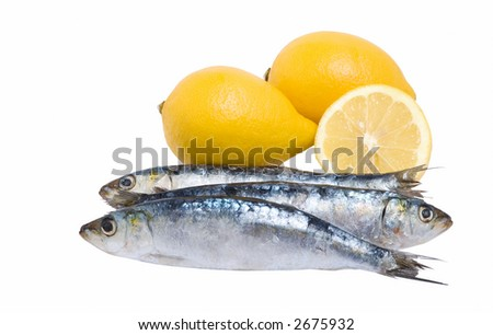 Close up off three sardines and lemons
