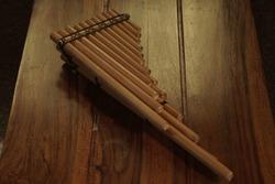 Close up off Triple Peruvian Andes Pan Flute Musical Instrument handicraft artefact