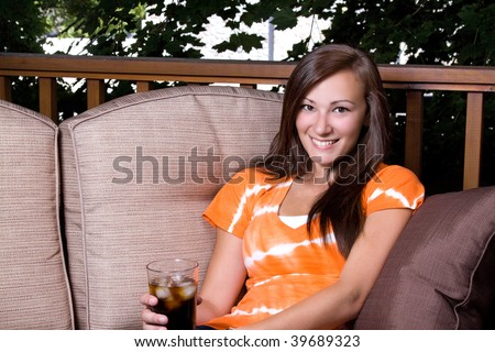 Close up on a Beautiful Girl Talking Drinking Soda Outside