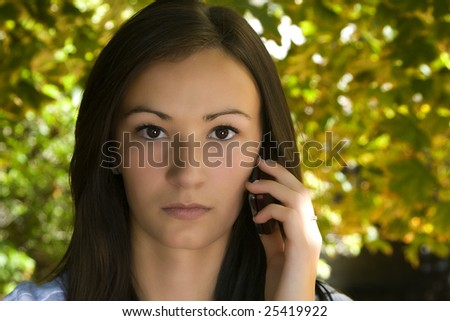 Close up on a Beautiful Girl Talking on a Cell Phone