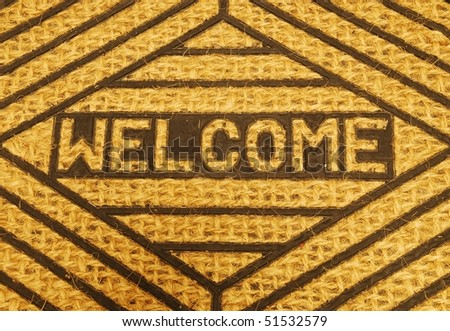 close-up on a beautiful welcome home door mat