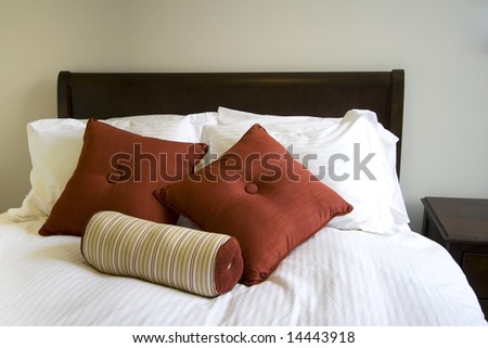 Close up on a bed in a bedroom - stock photo