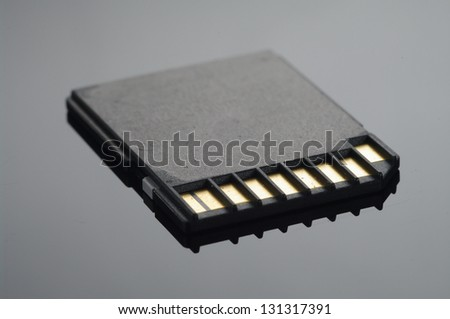 Close up on a black SD memory cards arranged over black