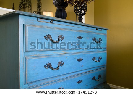 Close up on a blue dresser