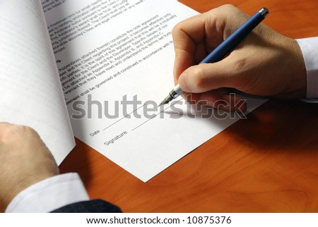 close up on a businessman hands signing a contract