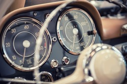 Close up on a dashboard of a vintage car