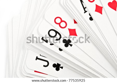 Close up on a deck of spread playing cards over white