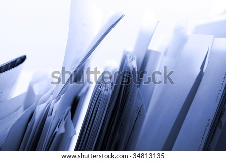 Close up on a Folders in a Rack - stock photo