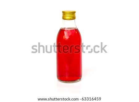 Close up on a medicine bottle with red syrup isolated on a white background.