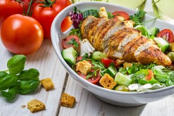 Close-up on a salad with chicken and tomato