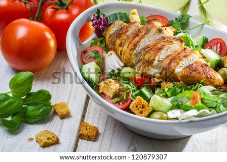 Close-up on a salad with chicken and tomato #120879307