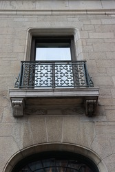 Close-up on a small decorative balcony with decorations and a metal ramp