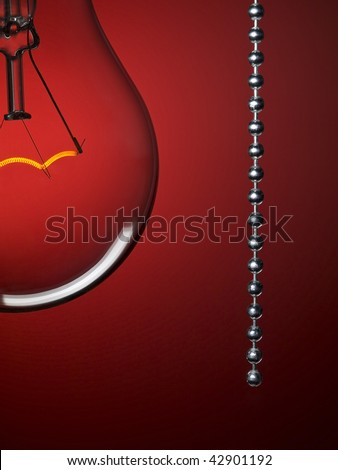 Close up on a transparent light bulb with a pull switch over a red background.