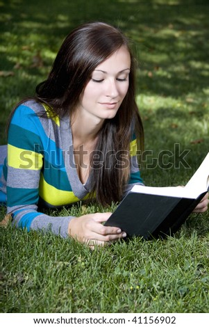 Close up on a Woman's Face Reading a Book