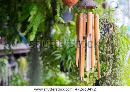 Close up on a wooden wind chime #472660492