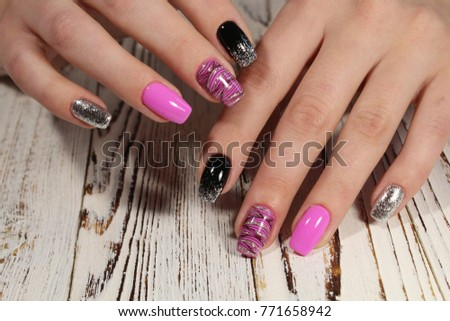 Close up on beautiful female hands with sexy manicure. #771658942