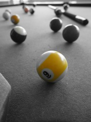 Close up on billiards balls, picture in black and white and monochrome special effect in yellow