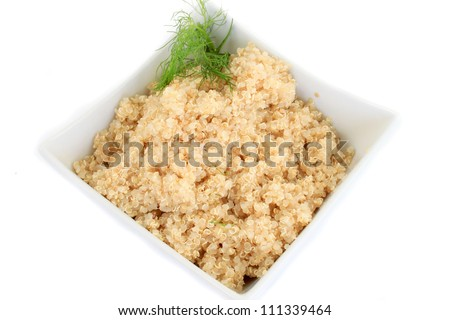 Close up on bowl  of cooked quinoa grain on white background