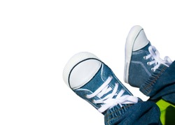 Close-up on child feet with sneakers.