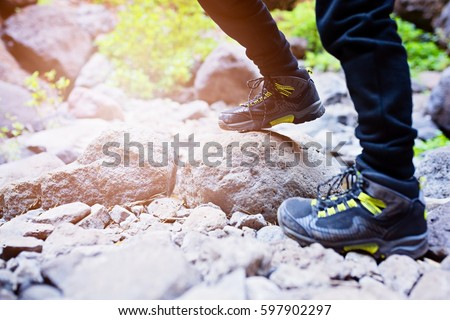 Close up on child trekking shoes on mountains trail. Mountain adventure. Masca Valley, Tenerife island, Canary Islands, Spain #597902297