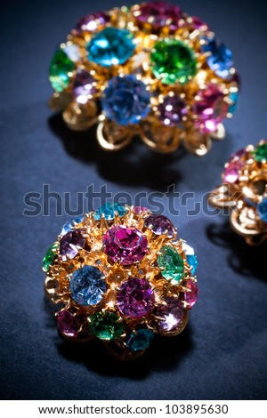 Close-up on colourful jewel-like buttons.