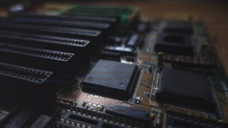Close up on computer motherboard. Concept of technologies and future engineering. Science and complexity on integrated PC circuit. Hardware background with a matte effect.