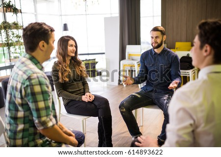 Close-up on discussion. Close-up of people communicating while sitting in circle and gesturing