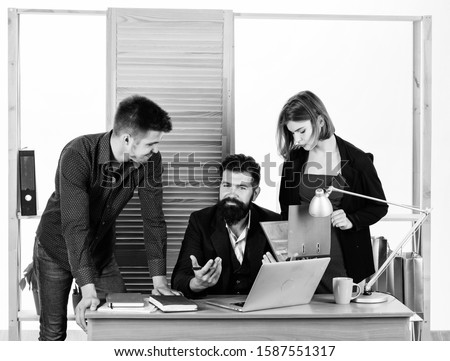 Close-up on discussion. Discussion group working and communicating at office desk together with colleagues. Professional people participating in business discussion. Discussion of a deal.