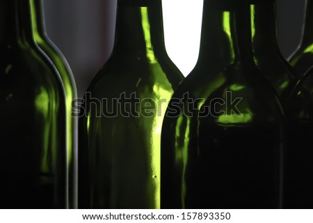 Close up on empty wine bottles without labels.