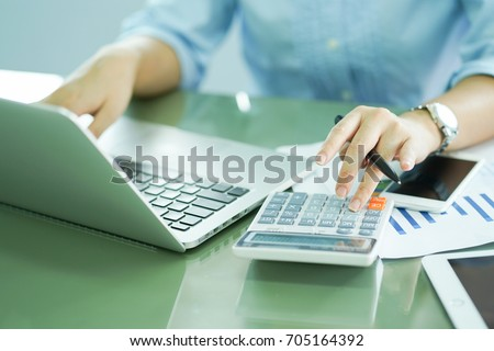 close up on finger hand press on calculator for computing,working woman concept.