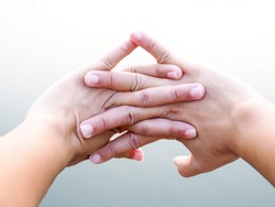 Close-up on fingers of asian people with hand stretched out and exercise in park to relax muscles relieve fatigue, Healthcare and medical concept.