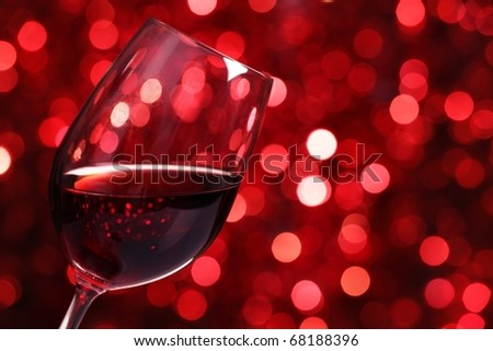 Close up on Glass of Red Wine with Lights Background.
