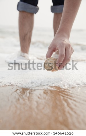 Close up on hand holding seashell #146641526