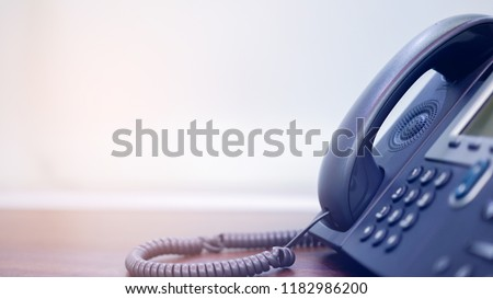 close up on handset telephone answer machine (VOIP system) at operation office desk with copy space for technology communication concept