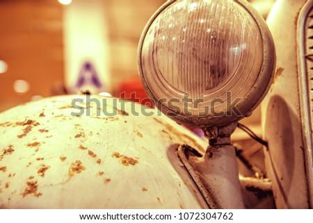 close-up on headlights or Headlight lamp of retro car  #1072304762