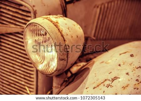 close-up on headlights or Headlight lamp of retro car  #1072305143