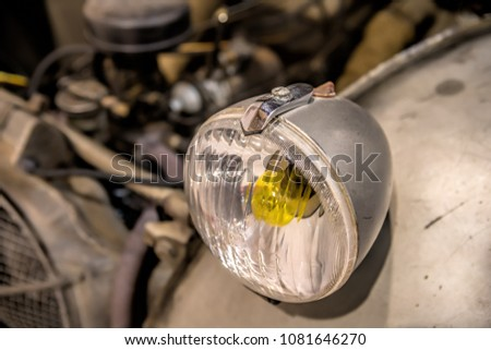 close-up on headlights or Headlight lamp of retro car  #1081646270