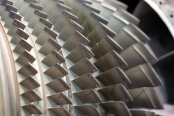 Close up on jet engine compressor blades.