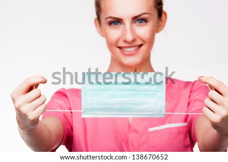close-up on medical mouth protection with smiling nurse