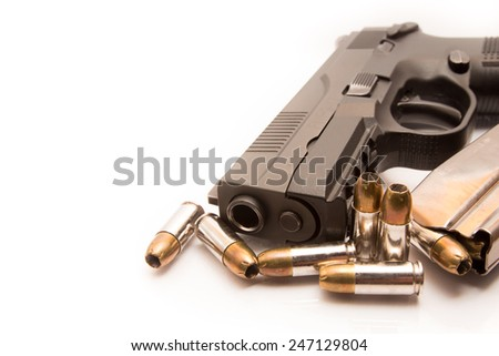 close-up on 9mm ammo with a handgun.