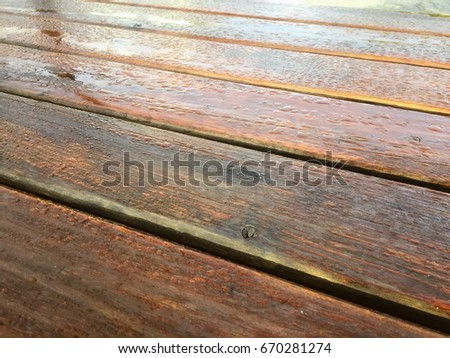 Close up on natural wet wood table surface #670281274