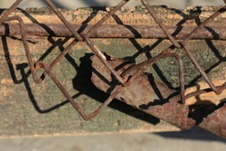 Close up on Old Rusty Metal Fence.  Rusty steel fence.