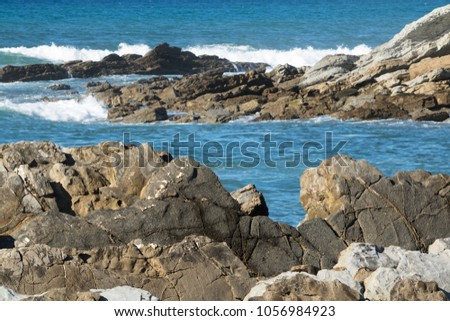 close up on powerful breaking waves of atlantic ocean against rocks, hendaye, basque country, france #1056984923