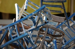 Close up on stack of old chairs
