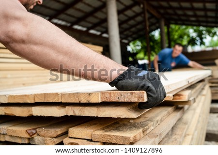 Close up on stack of rough sawn timber pine lumber planks construction material